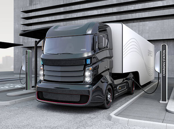 Hybrid electric truck being charging at charging station Hybrid electric truck being charging at charging station. 3D rendering image. electricity stock pictures, royalty-free photos & images