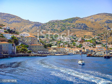 In August 2011, a sailboat is leaving the island of Hydra in Greece.