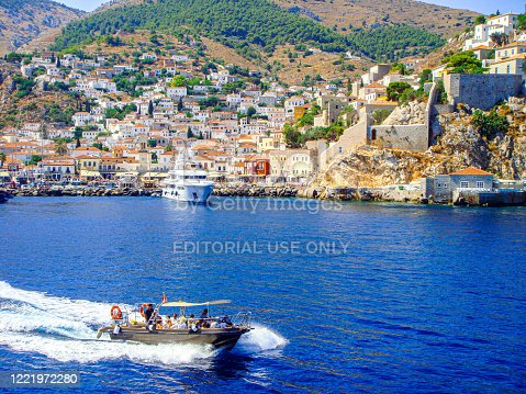 In August 2011, a boat is leaving the island of Hydra is Greece.