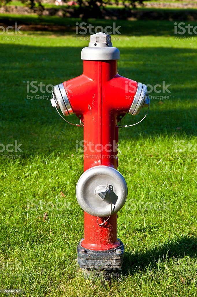 hydrant at the meadow stock photo