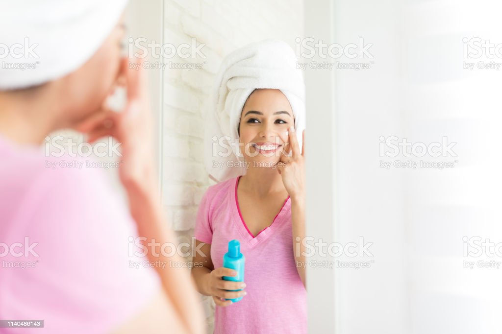 Hydrating Face With Moisturizer royalty-free stock photo