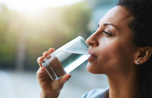 hydration is her beauty secret - drinking water stock photos and pictures