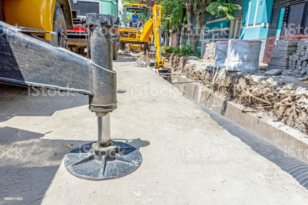 Hydraulic crane foot is supported for safety, Lateral stabilizer stock photo