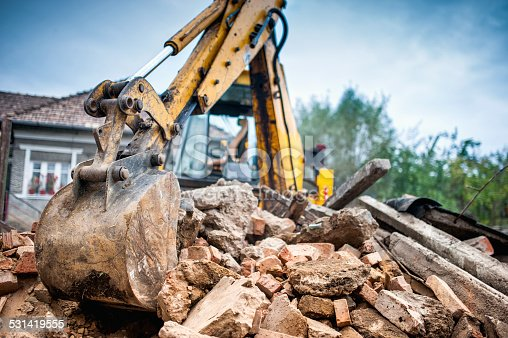 istock Hydraulic crusher excavator backoe machinery working on site demolition 531419555