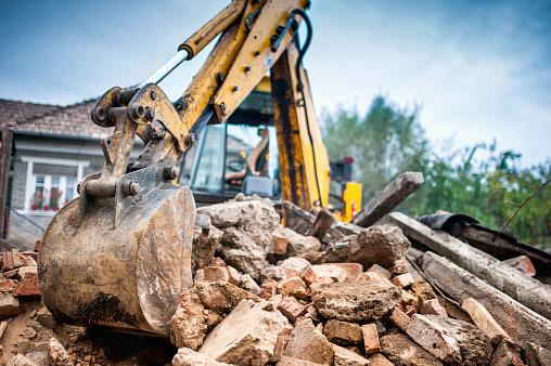 Hydraulic crusher excavator backoe machinery working on site demolition