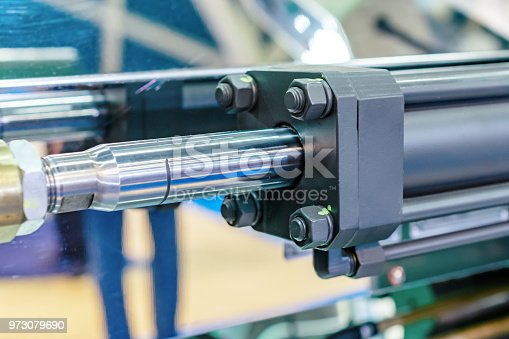 Hydraulic cylinder close-up. The main force control element of the mechanisms.