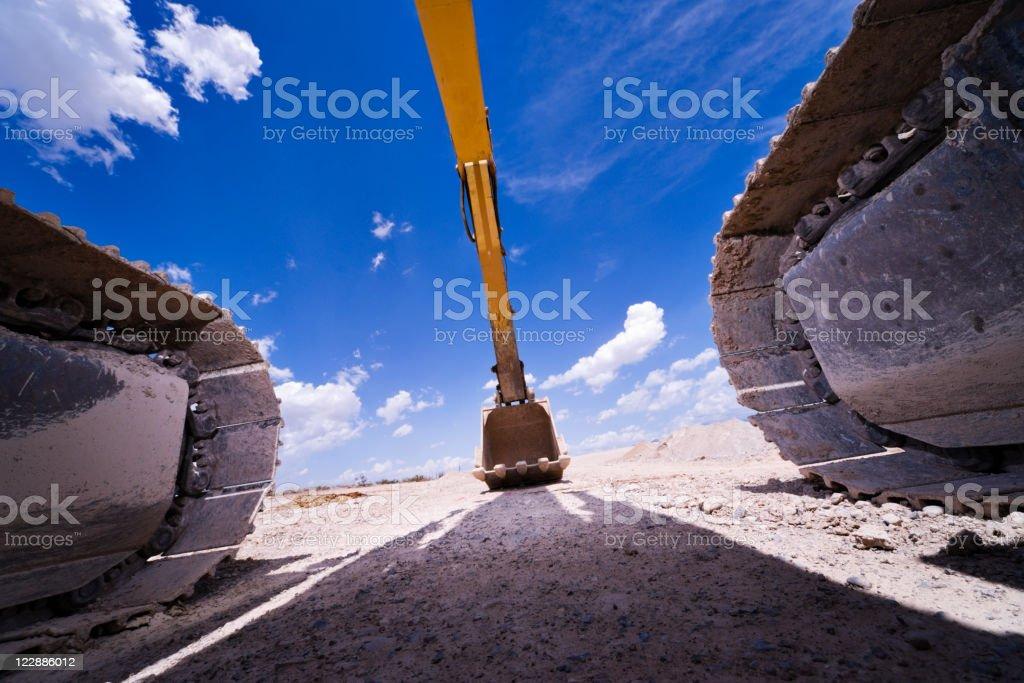 Hydraulic excavator shovel on land stock photo