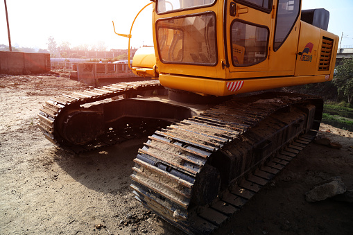 Delhi, India, June 14, 2015 : Yellow color hydraulic excavators standing on construction site.