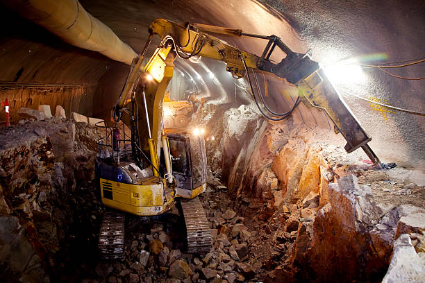 Hydraulic Hammer Excavator - Tunnel Construction stock photo