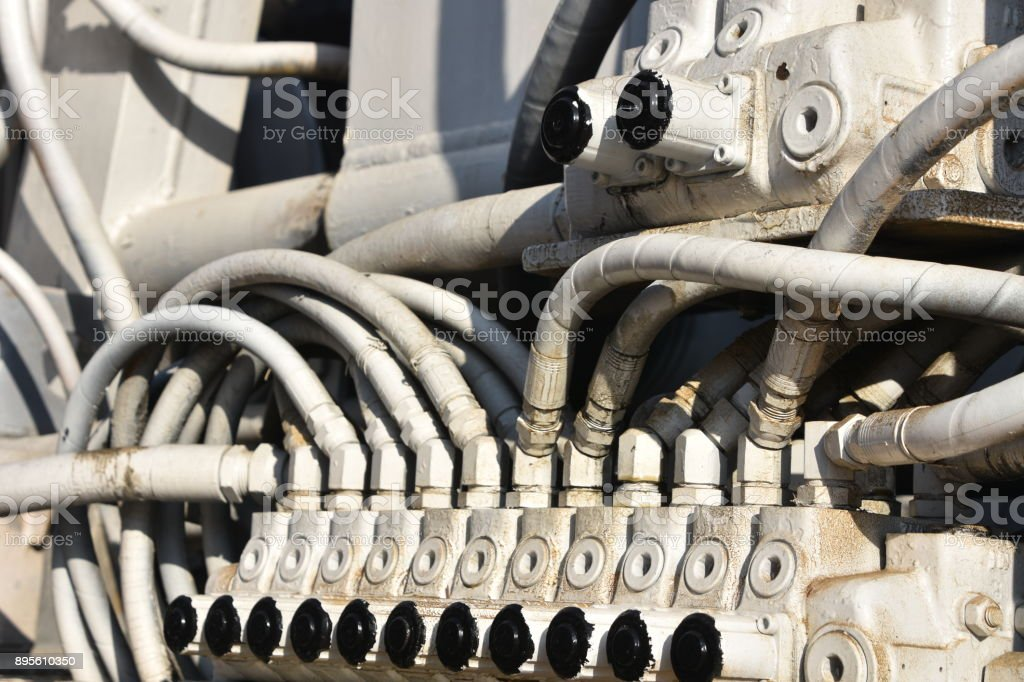 Hydraulic hoses in the truck stock photo