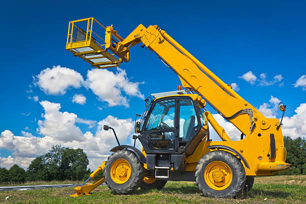 Hydraulic Lift Summer scene with yellow hydraulic lift mobile crane stock pictures, royalty-free photos & images