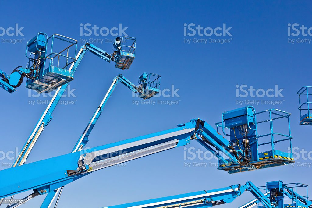 Hydraulic lifts against blue sky stock photo