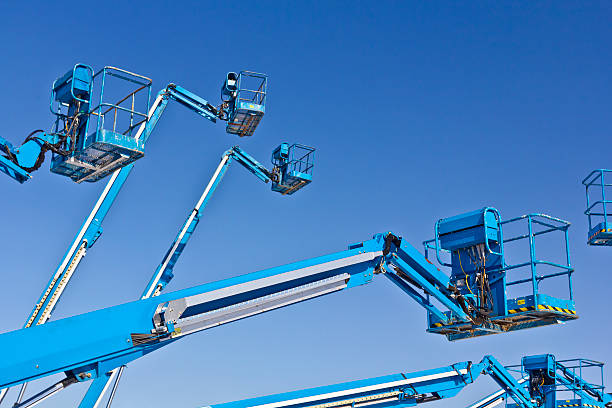 Hydraulic lifts against blue sky Hydraulic lifts against blue sky mobile crane stock pictures, royalty-free photos & images