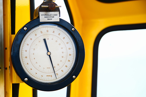 istock Hydraulic load indicator in control room, Gauge display 585526054