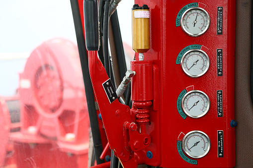 istock Hydraulic load indicator in control room, Gauge display to show status of hydraulic system and monitor by operator or expert, Maintenance routine job of the hydraulic system and other equipment. 1007036602