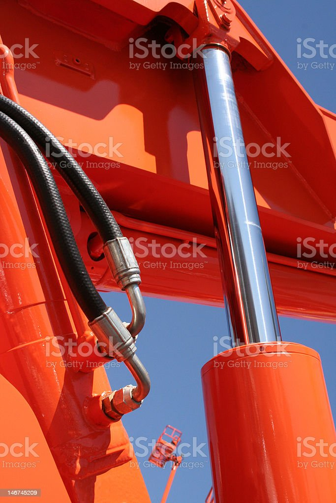 Hydraulic of an orange forklift royalty-free stock photo