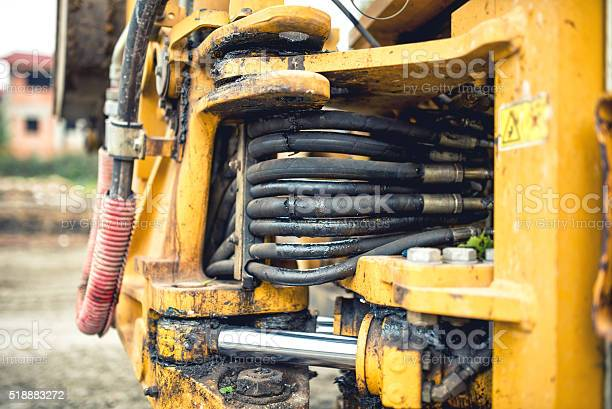 Hydraulic Pressure Pipes And Tubes Of Industrial Bulldozer Stock Photo - Download Image Now
