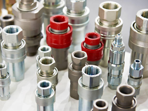 Hydraulic quick couplers Hydraulic quick couplers in store coupling device stock pictures, royalty-free photos & images