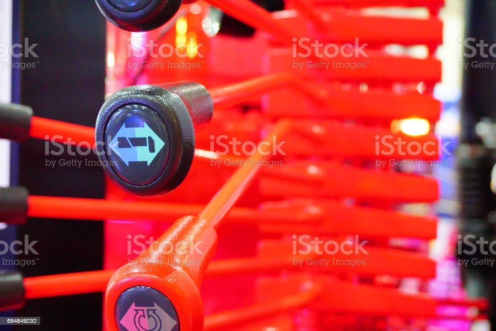 Hydraulic tubes, fittings and levers on control panel of mechani stock photo