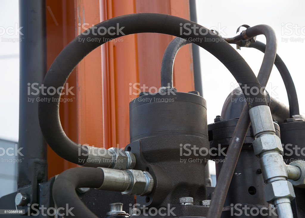 Hydraulic tubes, fittings and levers royalty-free stock photo