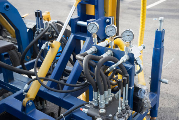 Hydraulic tubes fittings and  on control panel of lifting mechanism Hydraulic tubes fittings and manometers on control panel of lifting mechanism hose stock pictures, royalty-free photos & images