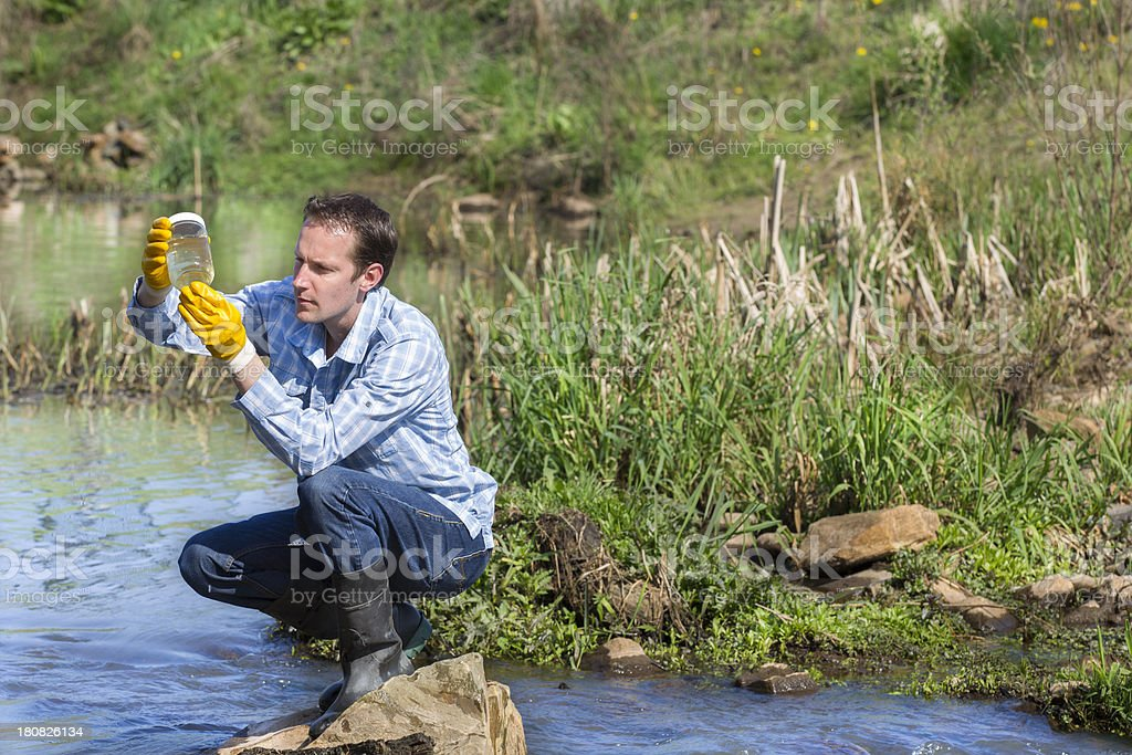 Hydro biologist testing quality of water royalty-free stock photo