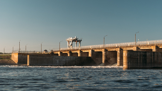 Hydro Dam At Water Reservoir Hydropower Plant At Sunset Stock Photo - Download Image Now