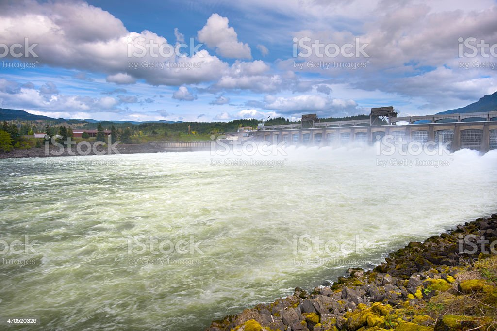 Hydro Dam with open spillway stock photo