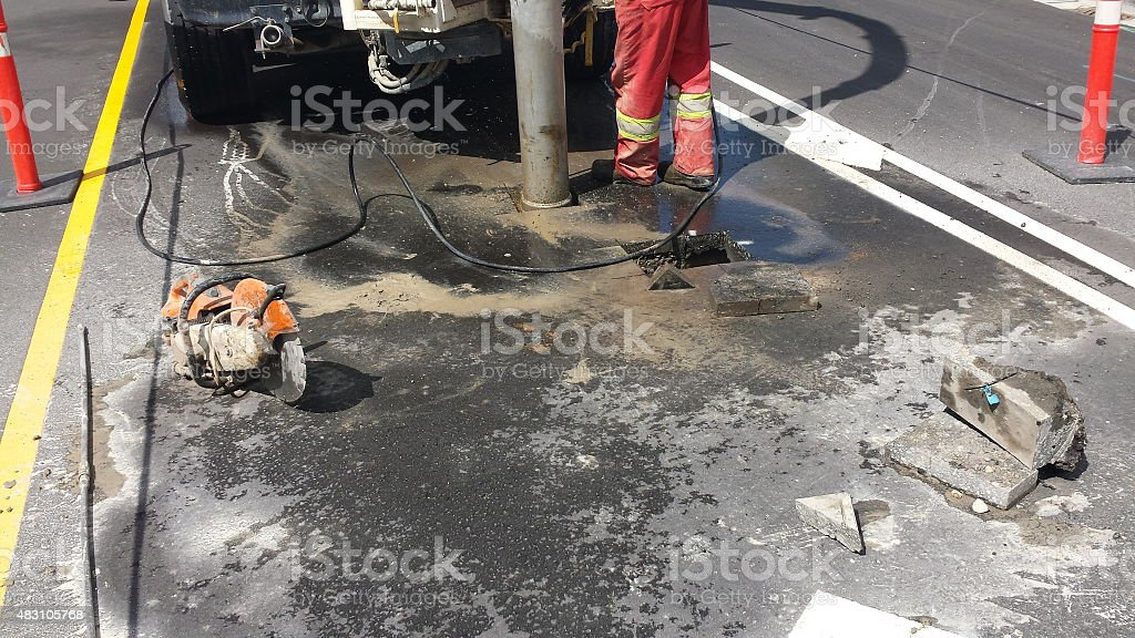 Hydro excavation on road to expose existing underground utiliy pipes stock photo