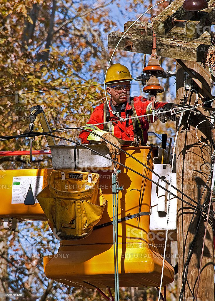Hydro Quebec Lineman Restoring Power in Connecticut after Nor'easter stock photo