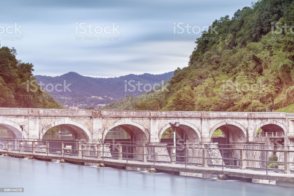 hydroelectric power plant on adda river stock photo