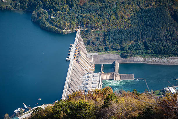Hydroelectric power plant on river stock photo