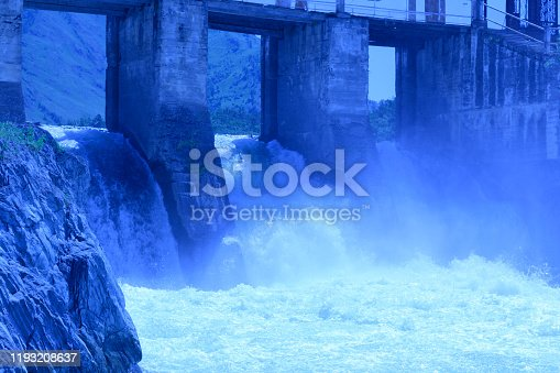 istock hydroelectric power station in the mountain Altai. Blue toned 1193208637