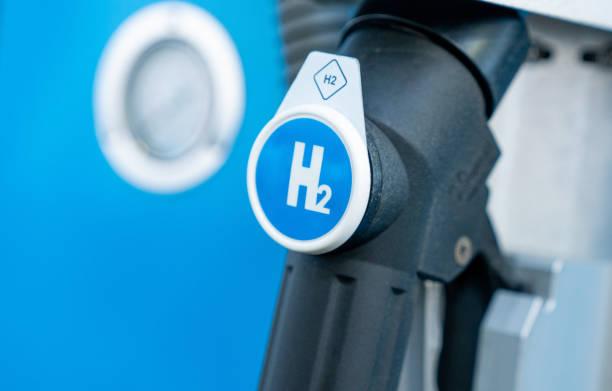 Hydrogen logo on gas stations fuel dispenser. h2 combustion engine for emission free eco friendly transport. stock photo