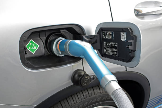 hydrogen refueling on the hydrogen filling station on the motor show - idrogeno foto e immagini stock