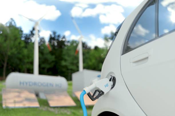 rifornimento di idrogeno l'auto per il trasporto ecologico con pannelli solari, turbine eoliche e sfondo serbatoio idrogeno - pila a idrogeno foto e immagini stock