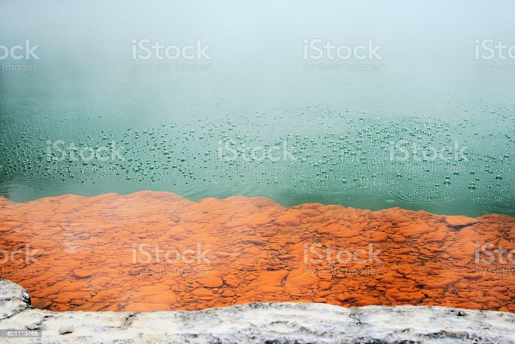 Hydrothermal bubbles in the Champagne Pool colorful spring stock photo