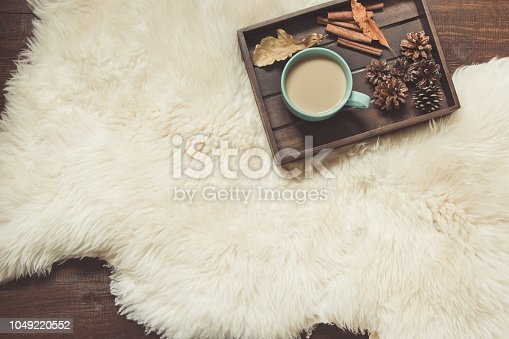 Hygge still life with hot cup of black coffee, anise, warm scarf on wooden board. Copy space. View from above.