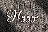 Hygge written word on a colorful knittwear
