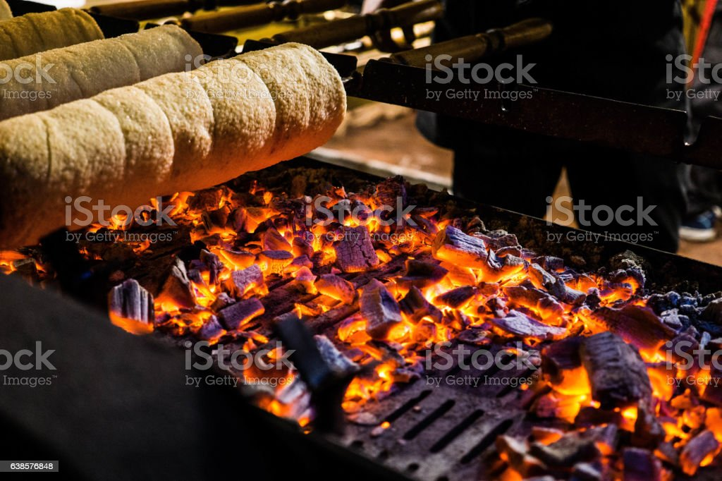 Hyggeligt Chimney Cake Being Baked Over an Open Grill stock photo