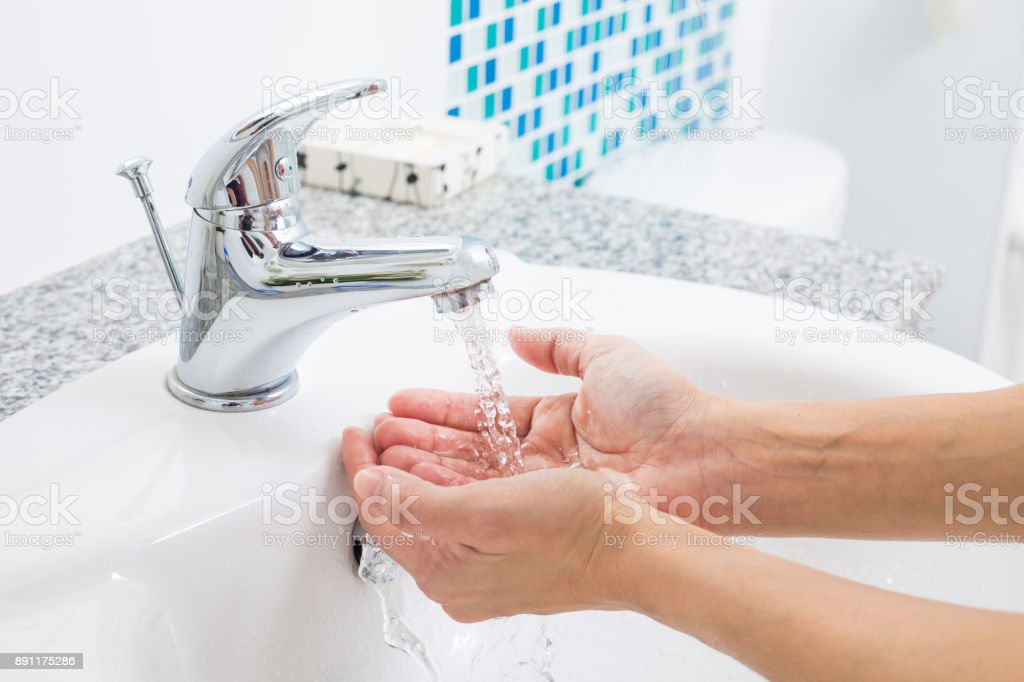 Hygiene. Cleaning Hands with water. Washing hands on sink. stock photo