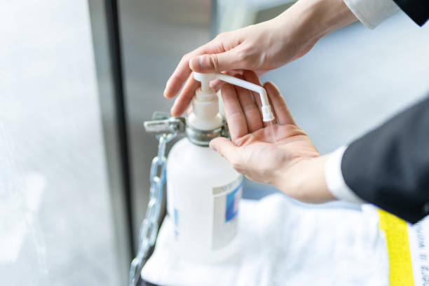 Hygiene Hand Disinfection, hands of young Asian businessman Hygiene Hand Disinfection, hands of young Japanese businessman antiseptic stock pictures, royalty-free photos & images