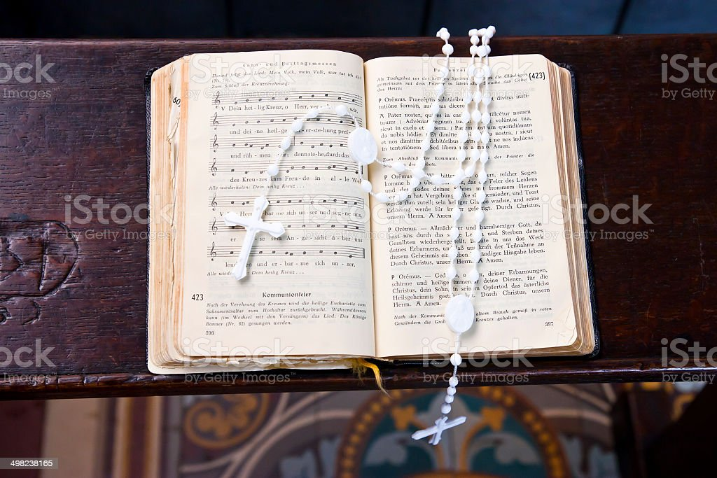 Hymn Book with Rosary stock photo