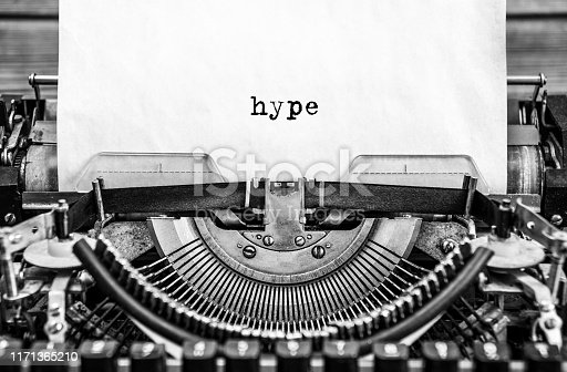 hype printed on a vintage typewriter. Close up.