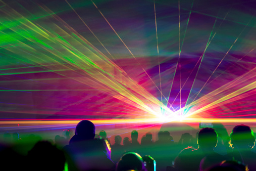 Very colorful show with a crowd silhouette and great laser rays on pyrotechnic festival in germany