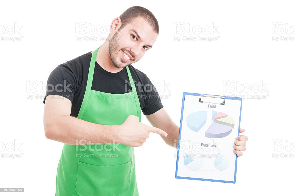 Hypermarket clerk pointing on profit and predictions clipboard stock photo