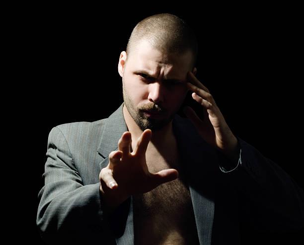 hypnotische mann - gedanken lesen stock-fotos und bilder