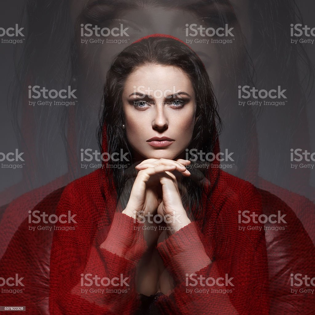 Hypnotic woman in little riding hood outfit stock photo