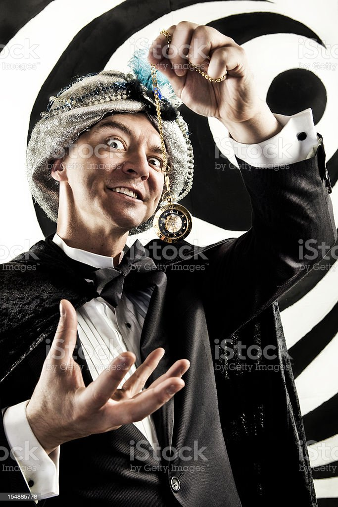 Hypnotist in front of abstract background stock photo