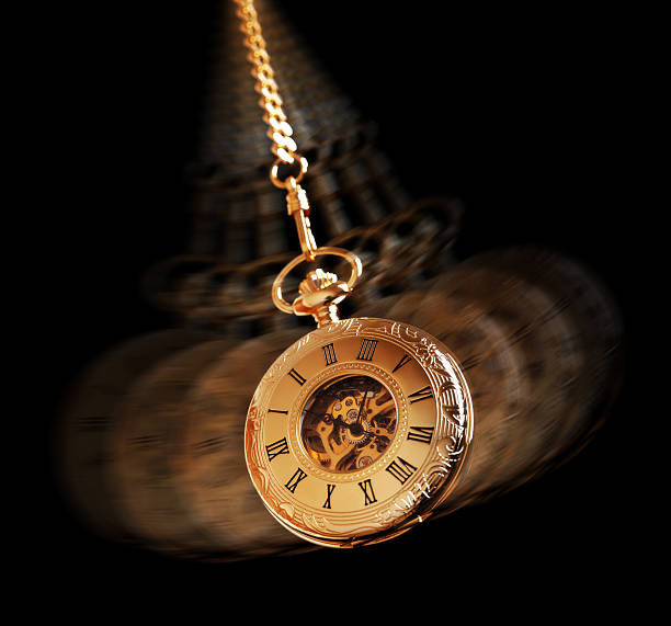 hypnotizing pocket watch - pendulum stock photos and pictures